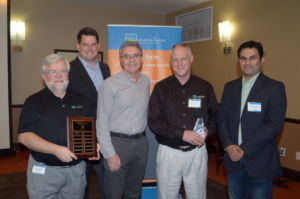 Executive team presents Rick Rohall with top sales award.